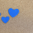 Blue hearts made of felt on golden background — Stock Photo #37294393