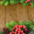 Christmas tree branches on wooden background — Stock Photo