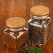 Stock Photo: Jars of different coffee on wooden background