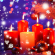 Composition with candles and Christmas decorations, on white carpet on bright background — Stok fotoğraf #37296891