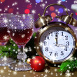 Wine glasses, retro alarm clock and Christmas decoration on bright background — Stock Photo