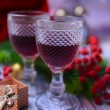 Stock Photo: Wine glasses and Christmas decoration on bright background