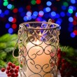 Stock Photo: Candle and Christmas tree bud on wooden table on bright background background