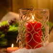 Stock Photo: Candles and Christmas decoration on wooden background