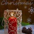 Stock Photo: Candle and Christmas tree bud on wooden background