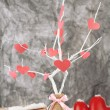 Decorative branch with hearts, on grey background — Stock Photo #37297037