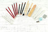 Professional art materials, on wooden table — Stock Photo
