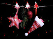 Santa hat and Christmas accessories on black background with lights — Stock Photo