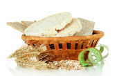 Tasty crispbread in basket, isolated on white — Stock Photo