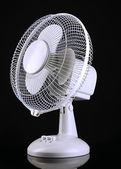 Electric fan on black background — Stock Photo
