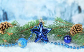 Composition of the Christmas decorations on light winter background — Photo