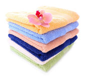 Orchid flower and towels, isolated on white — Stock Photo