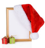 Christmas hat hung on old frame isolated on white — Stock Photo