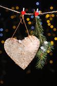 Decorative heart on rope on shiny background — Stock Photo