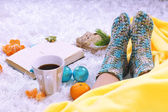 Composition with warm plaid, book,k and female legs, on color carpet background — 图库照片