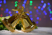 Christmas decorations on wooden table, on bright background — ストック写真