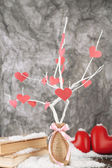 Decorative branch with hearts, on grey background — Stock Photo