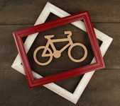 Decorative bicycle with frames on paper background — Stock Photo