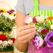 Florist makes flowers bouquet — Stock Photo #37356275