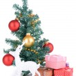Decorative Christmas tree with gifts isolated on white — Stock Photo