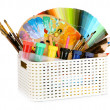 Stock Photo: Plastic basket with art supplies isolated on white