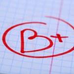 Grade B written on an exam paper — Stock Photo