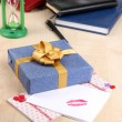 Gift with card for loved one on desktop close-up — Stock Photo #37359271