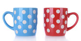 Color polka dot mugs isolated on white — Stock Photo