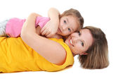 Beautiful mom with little daughter isolated on white — Stock Photo