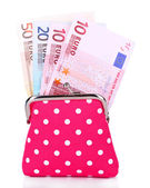 Pink purse with money isolated on white — Stok fotoğraf