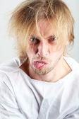 Mentally ill man in strait-jacket on gray background — Stock Photo