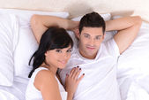 Couple in love sleeping in bed — Foto Stock