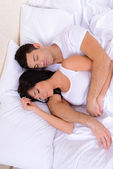 Couple in love sleeping in bed — 图库照片