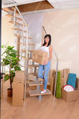Young woman moves into new home — Stock Photo