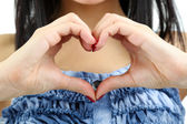 Woman hands making sign Heart close up — Stock Photo