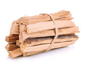 Stack of firewood isolated on white — Stock Photo