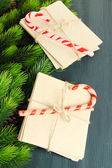 Christmas candy canes and letters for Santa, on color wooden background — Photo