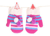 Striped mittens hanging on clothesline isolated on white — Stock Photo