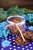 Delicious Christmas cookies in jar on table on wooden background — 图库照片