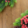Stock Photo: Christmas tree branches on wooden background