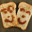 Stock Photo: Funny toasts, on wooden background