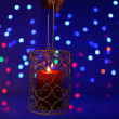 Stock Photo: Candle on blur lights background