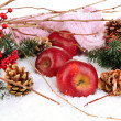 Stock Photo: Red apples with fir branches and knitted scarf in snow close up