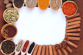 Various spices and herbs with empty white blank for recipe — Stock Photo