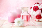 Glass bottle with color essence, on pink background — Stock Photo