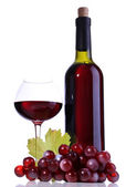 Wineglass with red wine, grape and bottle isolated on white — Stock Photo