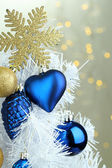 Toys on Christmas tree on Christmas lights background — Stock Photo