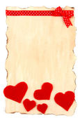 Beautiful sheet of paper with decorative hearts, isolated on white — Foto Stock