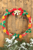 Beautiful Christmas wreath, on wooden background — Стоковое фото
