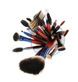 Makeup brushes in glass isolated on white — Stock Photo